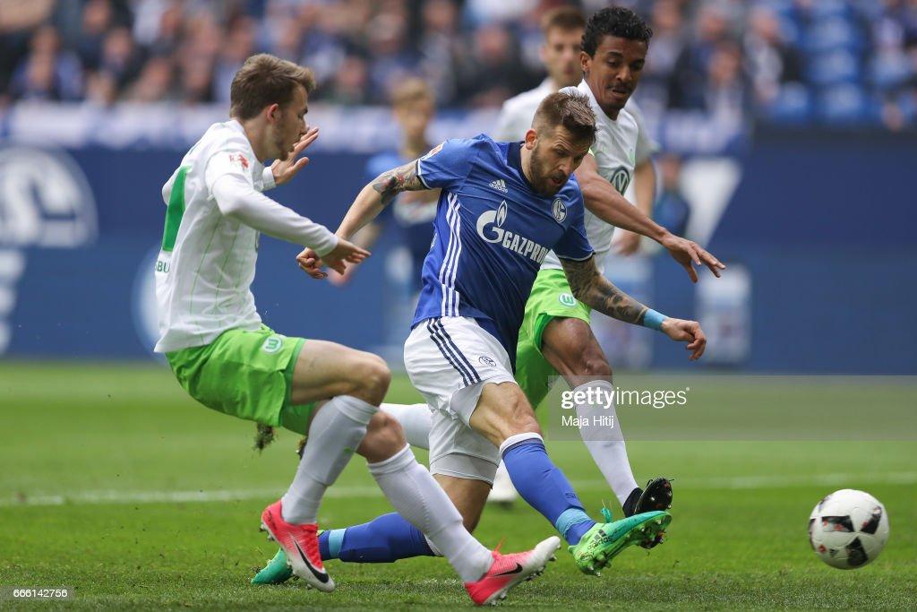 Guido Burgstaller of Schalke (C) scores a goal to make it 1-0 during the Bundesliga match between FC Schalke 04 and VfL Wolfsburg at Veltins-Arena on April 8, 2017 in Gelsenkirchen, Germany.