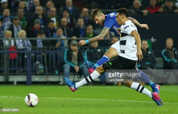 Guido Burgstaller of Schalke scores their first and equalising goal during the UEFA Europa League Round of 16 first leg match between FC Schalke 04...
