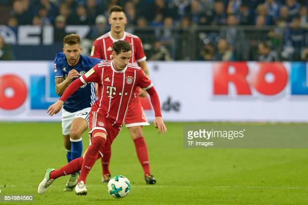 Guido Burgstaller of Schalke Sebastian Rudy of Muenchen battle for the ball during the Bundesliga match between FC Schalke 04 and FC Bayern Muenchen...