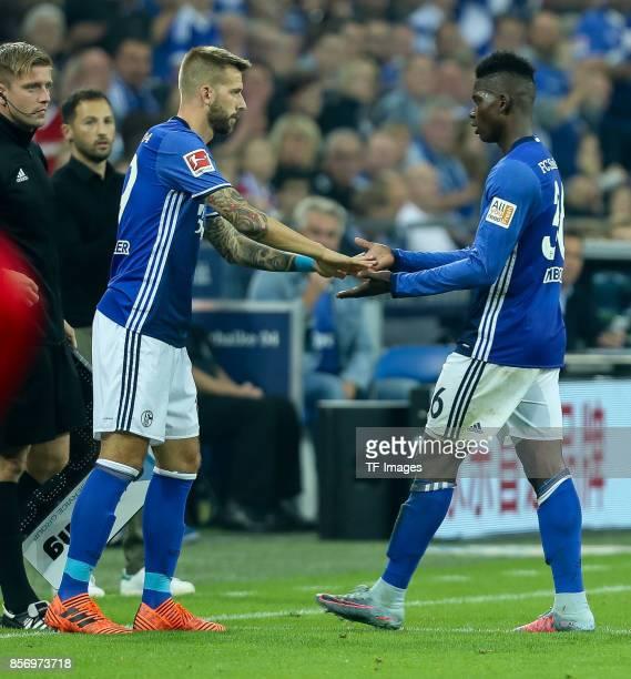 Guido Burgstaller of Schalke shakes hands with Breel Embolo of Schalke during the Bundesliga match between FC Schalke 04 and Bayer 04 Leverkusen at...