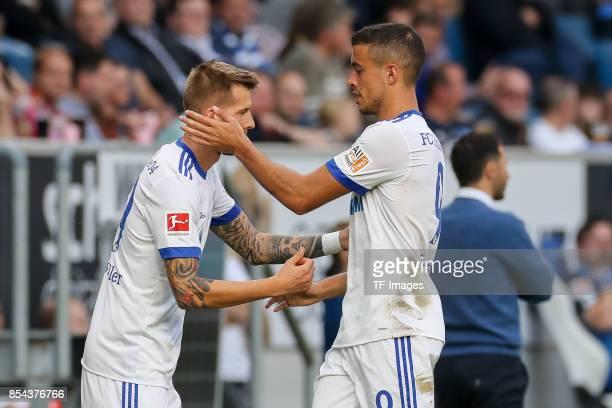 Guido Burgstaller of Schalke shakes hands with Franco Matias Di Santo of Schalke during the Bundesliga match between TSG 1899 Hoffenheim and FC...