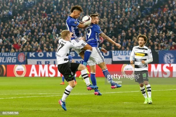 Guido Burgstaller of Schalke Thilo Kehrer of Schalke and Oscar Wendt of Borussia Moenchengladbach battle for the ball during the UEFA Europa League...