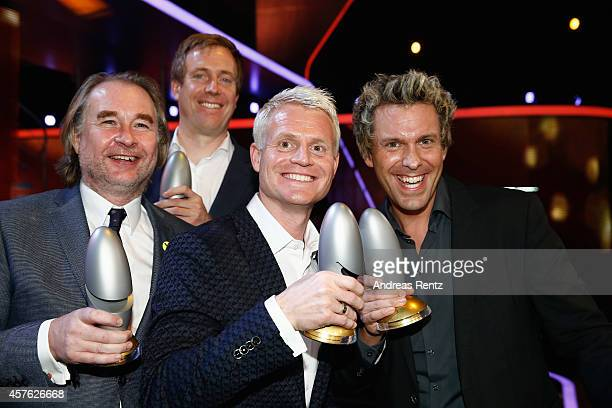 Guido Cantz and Sascha Grammel pose with their awards during the 18th Annual German Comedy Awards at Coloneum on October 21 2014 in Cologne Germany...
