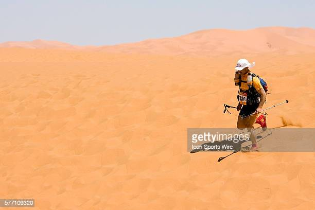 Guido Carlin of Italia runs down a dune during the sixth and final stage of the 22nd Marathon des Sables between erg Chebbi dunes and village of...