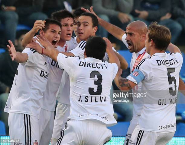 Guido Carrillo celebrates with teammates after scoring the opening goal during a match between Tigre and Estudiantes as part of 19th round of Torneo...