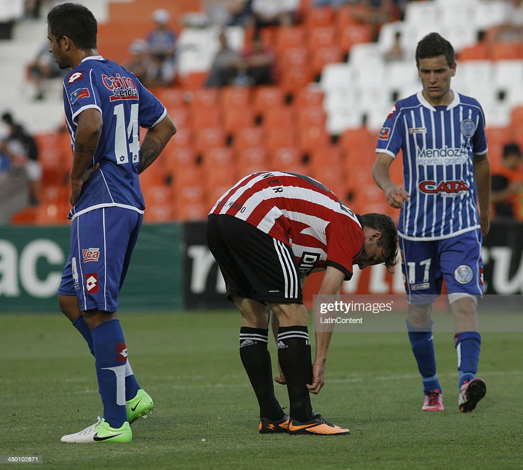 Guido Carrillo of Estudiantes adjust his socks during a match between Godoy Cruz and Estudiantes as part of Torneo Inicial at Mundialista Stadium on November 16, 2013 in Mendoza, Argentina.