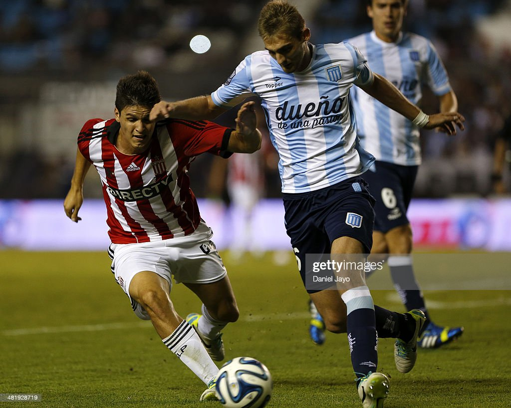 Guido Carrillo, of Estudiantes, (L) and Matias Cahais, of Racing Club, vie for the ball during a match between Racing Club and Estudiantes as part of 11th round of Torneo Final 2014 at Presidente Peron Stadium on April 1, 2014 in Buenos Aires, Argentina.