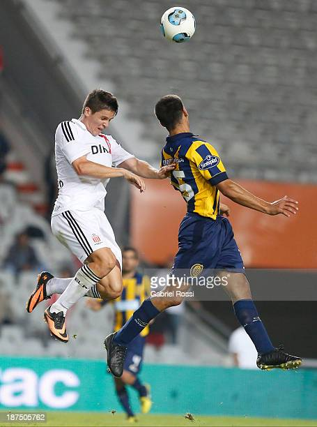 Guido Carrillo of Estudiantes fights for the ball with Lisandro Magallan of Rosario Central during a match between Estudiantes and Rosario Central as...