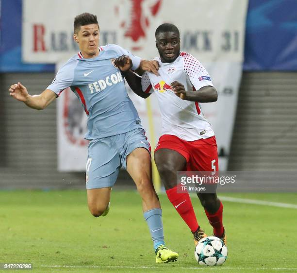 Guido Carrillo of Monaco and Dayot Upamecano of Leipzig battle for the ball during the UEFA Champions League group G match between RB Leipzig and AS...