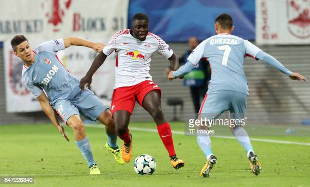 Guido Carrillo of Monaco and Dayot Upamecano of Leipzig Rachid Ghezzal of Monaco battle for the ball during the UEFA Champions League group G match...