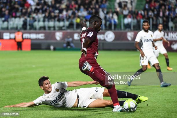 Guido Carrillo of Monaco and Falliy Diagne of Metz during the Ligue 1 match between FC Metz and AS Monaco on August 18 2017 in Metz