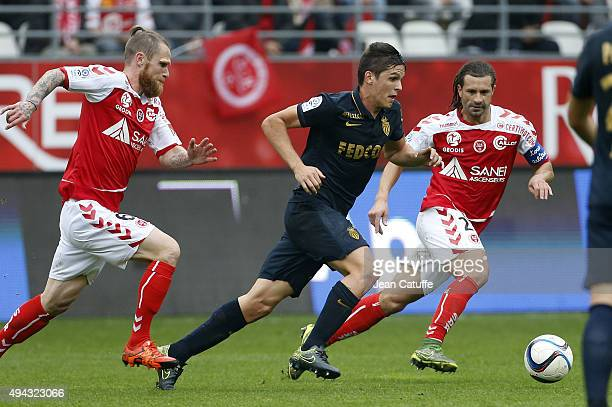 Guido Carrillo of Monaco in action between Antoine Devaux and Mickael Tacalfred of Stade de Reims during the French Ligue 1 match between Stade de...