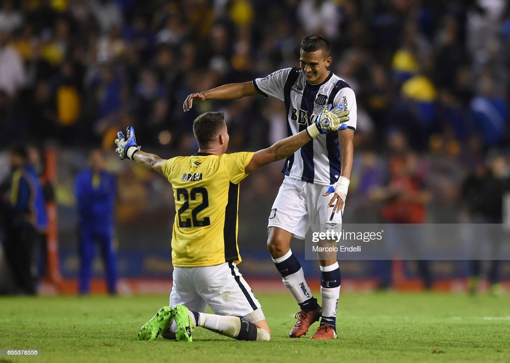 Guido Herrera and Victor Ramis of Talleres celebrate after winning a match between Boca Juniors and Talleres as part of Torneo Primera Division 2016/17 at Alberto J Armando Stadium on March 12, 2017 in Buenos Aires, Argentina.