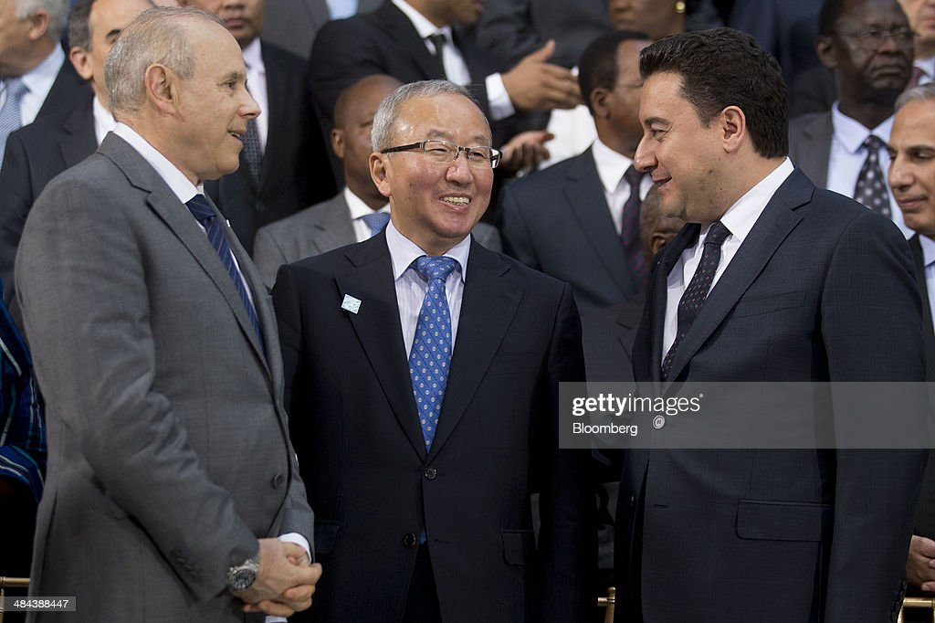 <a gi-track='captionPersonalityLinkClicked' href=/galleries/search?phrase=Guido+Mantega&family=editorial&specificpeople=574704 ng-click='$event.stopPropagation()'>Guido Mantega</a>, Brazil's finance minister, from left, Hyun Oh Seok, South Korea's finance minister, and <a gi-track='captionPersonalityLinkClicked' href=/galleries/search?phrase=Ali+Babacan&family=editorial&specificpeople=612964 ng-click='$event.stopPropagation()'>Ali Babacan</a>, Turkey's deputy prime minister, talk during the International Monetary Fund (IMF) governors family photograph at the IMF and World Bank Group Spring Meetings in Washington, D.C., U.S., on Saturday, April 12, 2014. International central bankers pledged to take care in telegraphing monetary-policy shifts and consider their global effects amid renewed calls from emerging markets for greater cooperation. Photographer: Andrew Harrer/Bloomberg via Getty Images