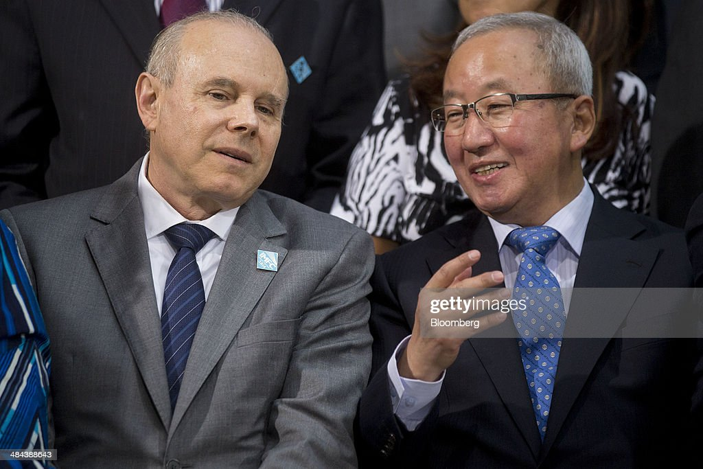 <a gi-track='captionPersonalityLinkClicked' href=/galleries/search?phrase=Guido+Mantega&family=editorial&specificpeople=574704 ng-click='$event.stopPropagation()'>Guido Mantega</a>, Brazil's finance minister, left, talks to Hyun Oh Seok, South Korea's finance minister, during the International Monetary Fund (IMF) governors family photograph at the IMF and World Bank Group Spring Meetings in Washington, D.C., U.S., on Saturday, April 12, 2014. International central bankers pledged to take care in telegraphing monetary-policy shifts and consider their global effects amid renewed calls from emerging markets for greater cooperation. Photographer: Andrew Harrer/Bloomberg via Getty Images