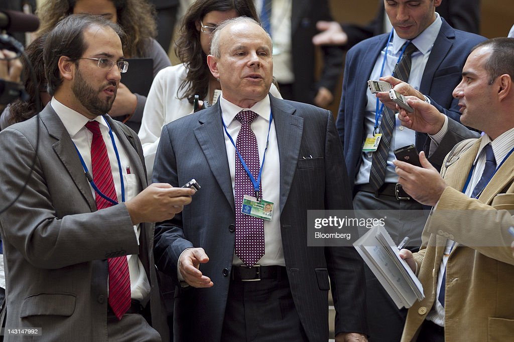 <a gi-track='captionPersonalityLinkClicked' href=/galleries/search?phrase=Guido+Mantega&family=editorial&specificpeople=574704 ng-click='$event.stopPropagation()'>Guido Mantega</a>, finance minister of Brazil, center, speaks to reporters after a meeting with finance officials from Russia, India, China and South Africa during the International Monetary Fund (IMF) and World Bank annual spring meetings in Washington, D.C., U.S., on Thursday, April 19, 2012. Brazil isn't ready to contribute more funding to the International Monetary Fund because some nations are dragging their feet implementing pledged reforms to give emerging markets a bigger say in how the Washington-based lender is run, Mantega said. Photographer: Andrew Harrer/Bloomberg via Getty Images