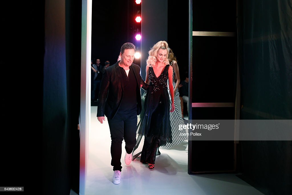 Guido Maria Kretschmer and a model leave the runway after his show during the Mercedes-Benz Fashion Week Berlin Spring/Summer 2017 at Erika Hess Eisstadion on June 29, 2016 in Berlin, Germany.