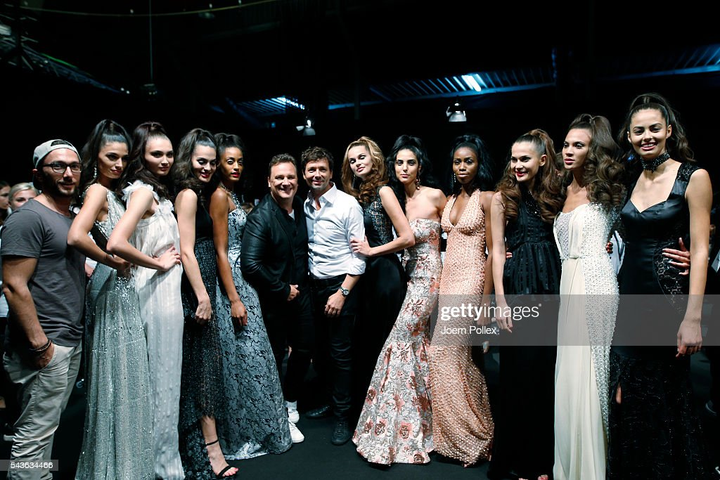 Guido Maria Kretschmer and Andre Maertens pose with models backstage after the Guido Maria Kretschmer show during the Mercedes-Benz Fashion Week Berlin Spring/Summer 2017 at Erika Hess Eisstadion on June 29, 2016 in Berlin, Germany.