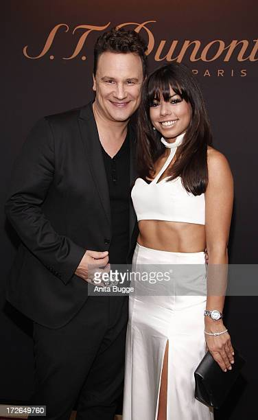 Guido Maria Kretschmer and Fernanda Brandao attend the launch of the new collection of STDupont with Karl Lagerfeld at Hotel Adlon on July 4 2013 in...