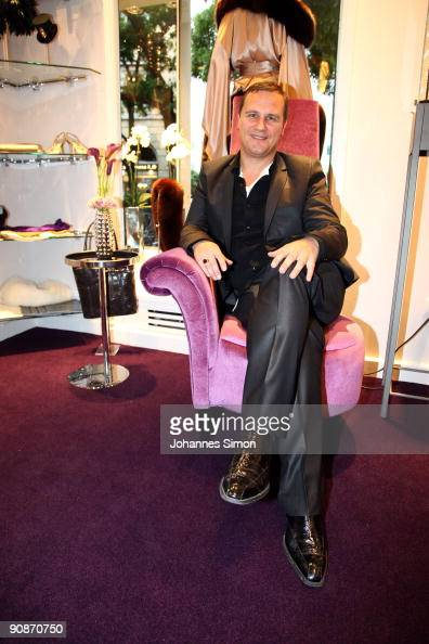 guido maria kretschmer poses ahead of the guido maria kretschmer shop. Black Bedroom Furniture Sets. Home Design Ideas