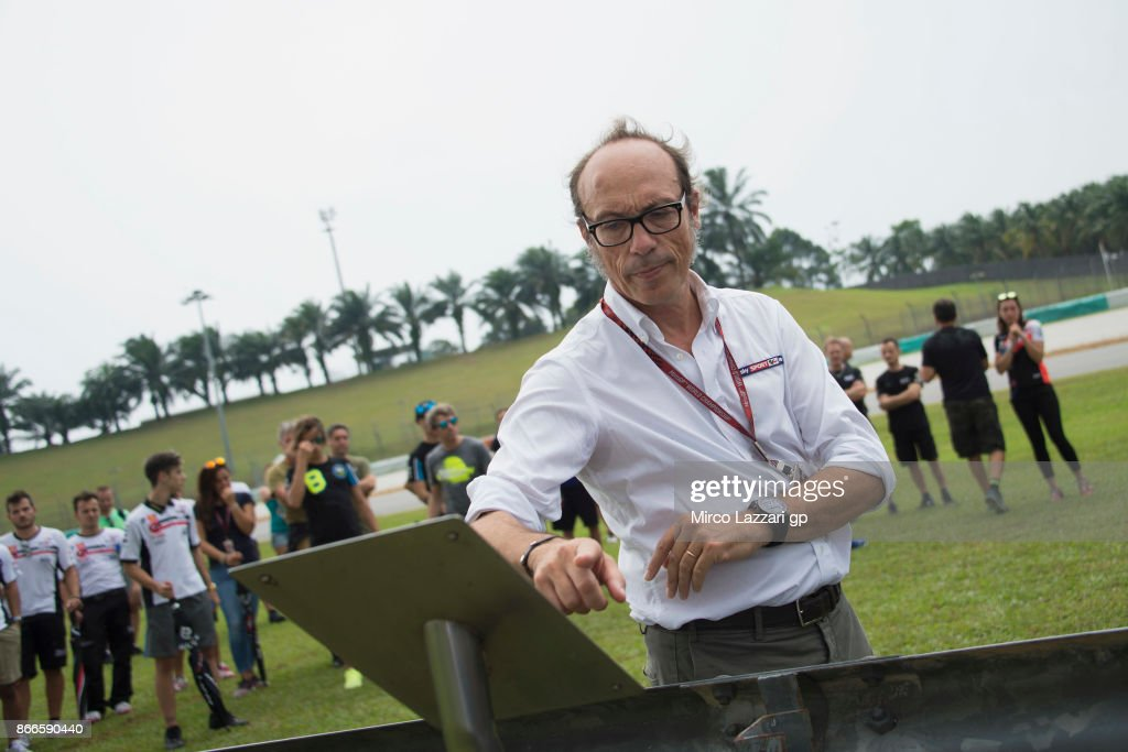 Guido Meda of Italy pray during the 'Track walk to Turn 11 for SIC ' ahead of the MotoGP of Malaysia at Sepang Circuit on October 26, 2017 in Kuala Lumpur, Malaysia.