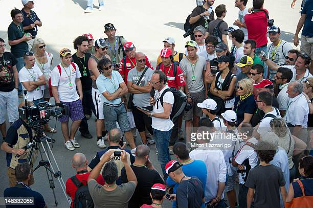 Guido Meda of Italy speaks on paddock in front of fans during the qualifying practice of MotoGP of Italy at Mugello Circuit on July 14 2012 in...
