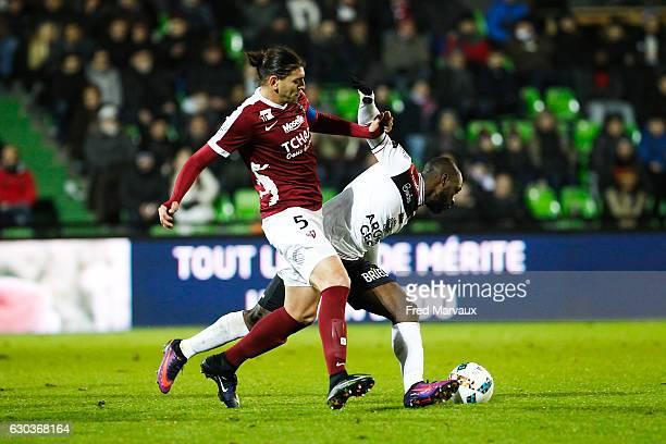 Guido Milan of Metz and Yannis Salibur of Guingamp during the Ligue 1 match between FC Metz and EA Guingamp at Stade SaintSymphorien on December 21...