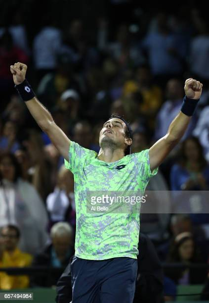 Guido Pella of Argentina celebrates match point against Grigor Dimitrov of Bulgaria during day 5 of the Miami Open at Crandon Park Tennis Center on...