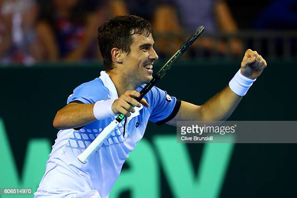 Guido Pella of Argentina celebrates victory in his singles match against Kyle Edmund of Great Britain during day one of the Davis Cup Semi Final...