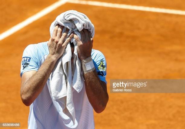 Guido Pella of Argentina dries up during a singles match between Guido Pella and Paolo Lorenzi as part day 1 of the Davis Cup 1st round match between...