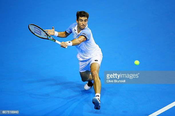 Guido Pella of Argentina hits a backhand durinng his singles match against Andy Murray of Great Britain during day three of the Davis Cup semi final...