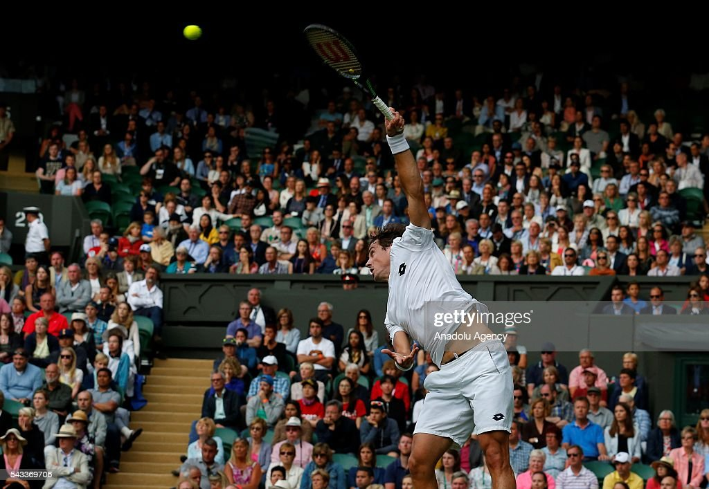 Guido Pella of Argentina in action against Roger Federer of Switzerland in the mens' singles on day one of the 2016 Wimbledon Championships at the All England Lawn Tennis and Croquet Club in London, United Kingdom on June 27, 2016.