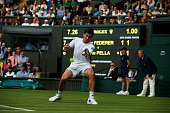 Guido Pella of Argentina in action against Roger Federer of Switzerland in the mens' singles on day one of the 2016 Wimbledon Championships at the...