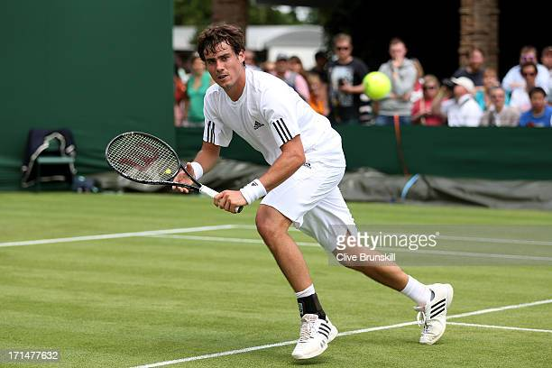 Guido Pella of Argentina in action during his Gentlemen's Singles first round match against Jesse Levine of Canada on day two of the Wimbledon Lawn...