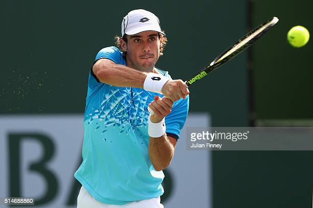 Guido Pella of Argentina plays a backhand against Kyle Edmund of Great Britain during day four of the BNP Paribas Open at Indian Wells Tennis Garden...