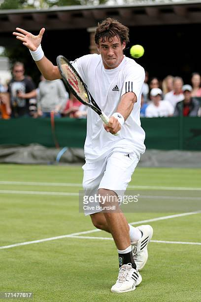 Guido Pella of Argentina plays a backhand during his Gentlemen's Singles first round match against Jesse Levine of Canada on day two of the Wimbledon...