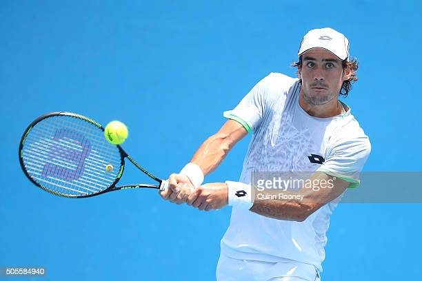 Guido Pella of Argentina plays a backhand in his first round match against Steve Darcis of Belgium during day two of the 2016 Australian Open at...
