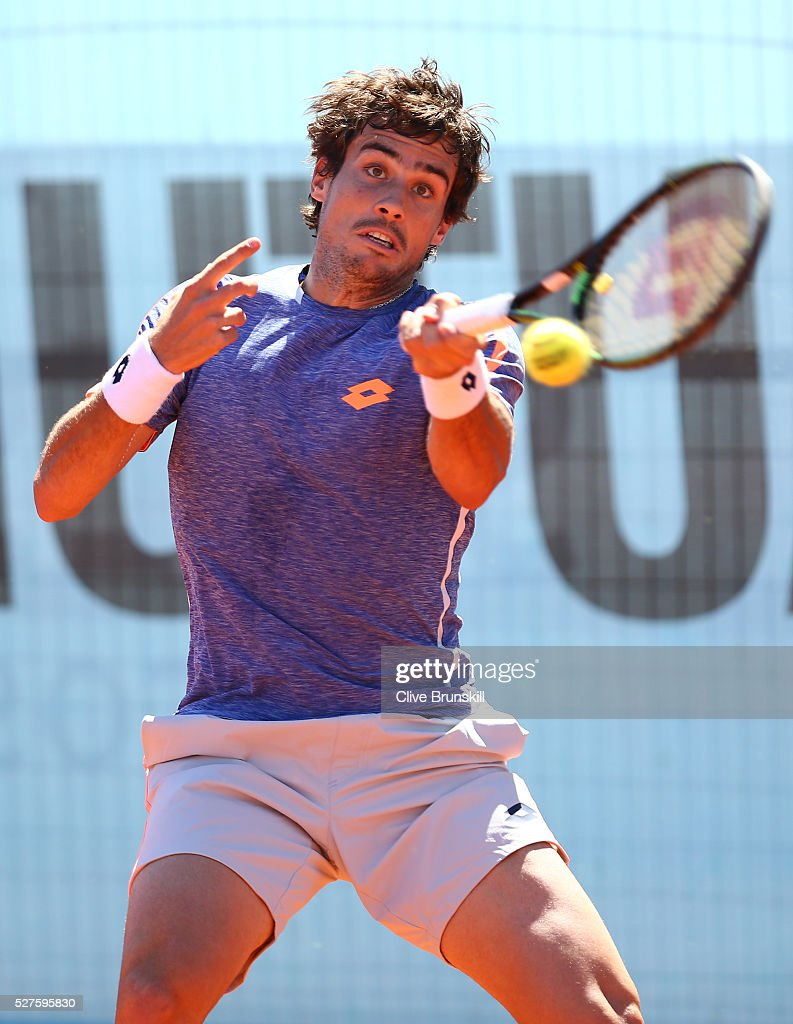 <a gi-track='captionPersonalityLinkClicked' href=/galleries/search?phrase=Guido+Pella&family=editorial&specificpeople=5366030 ng-click='$event.stopPropagation()'>Guido Pella</a> of Argentina plays a forehand against Nick Kyrgios of Australia in their first round match during day four of the Mutua Madrid Open tennis tournament at the Caja Magica on May 03, 2016 in Madrid,Spain.