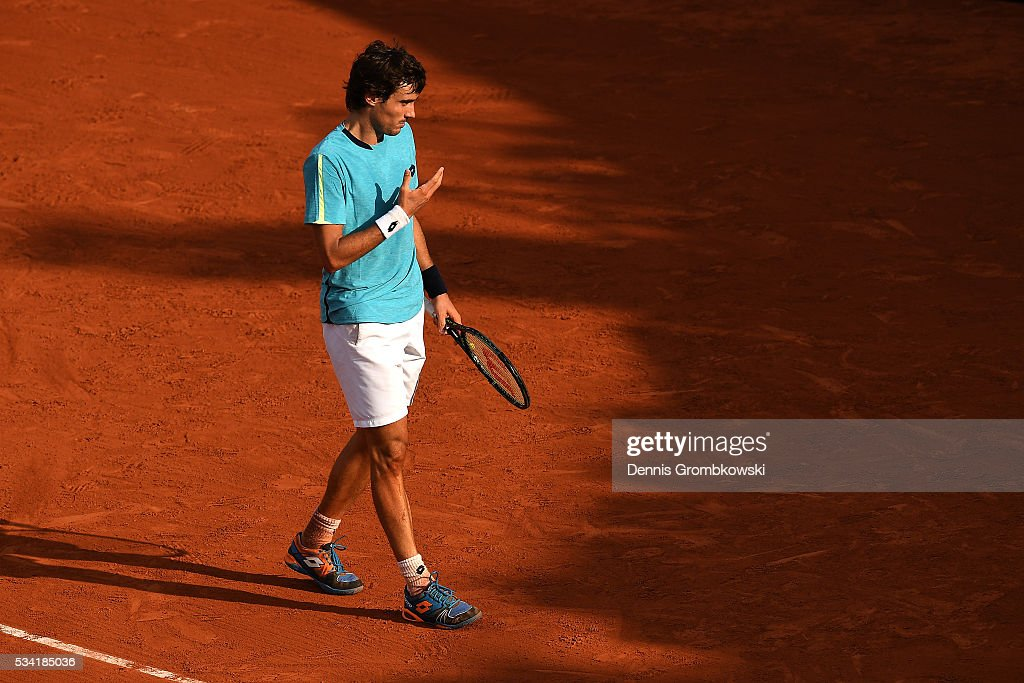 <a gi-track='captionPersonalityLinkClicked' href=/galleries/search?phrase=Guido+Pella&family=editorial&specificpeople=5366030 ng-click='$event.stopPropagation()'>Guido Pella</a> of Argentina reacts during the Men's Singles second round match against Gilles Simon of France on day four of the 2016 French Open at Roland Garros on May 25, 2016 in Paris, France.