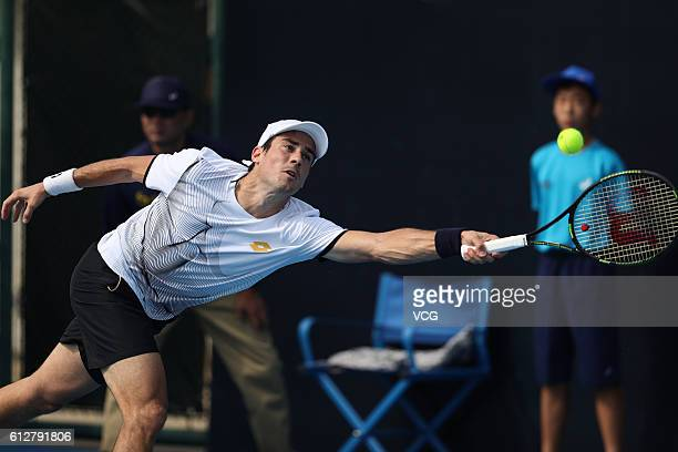 Guido Pella of Argentina returns a shot against Malek Jaziri of Tunisia during the Men's singles first round match on day five of the 2016 China Open...