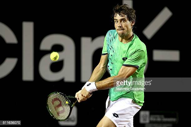 Guido Pella of Argentina returns a shot against Pablo Cuevas of Uraguay during the final of the Rio Open at Jockey Club Brasileiro on February 21...