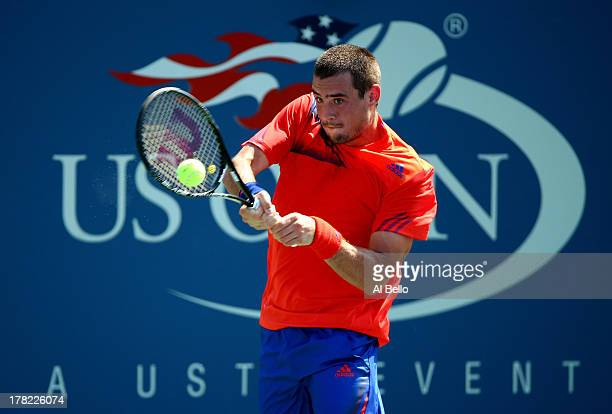 Guido Pella of Argentina returns a shot to Sam Querry of United States of America during their first round men's singles match on Day Two of the 2013...