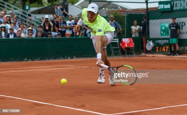 Guido Pella of Argentina returns the ball to Juan Martin Del Potro of Argentina during the first round at Roland Garros Grand Slam Tournament Day 3...