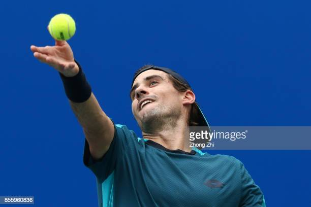 Guido Pella of Argentina serves during the semi final match against Marcos Baghdatis of Cyprus during Day 6 of 2017 ATP Chengdu Open at Sichuan...