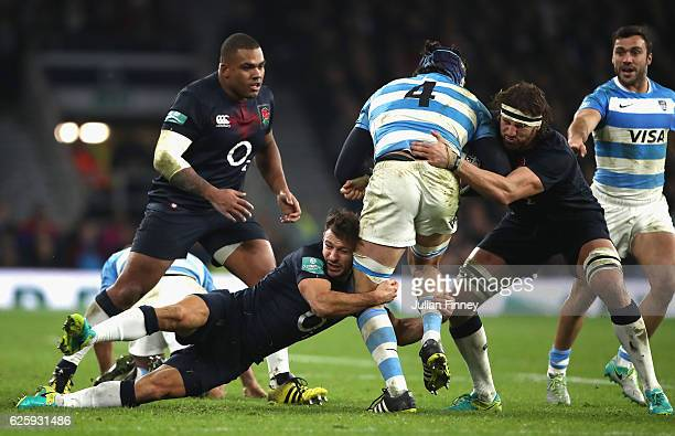 Guido Peti of Argentina is tackled by Danny Care and Tom Wood of England during the Old Mutual Wealth Series match between England and Argentina at...