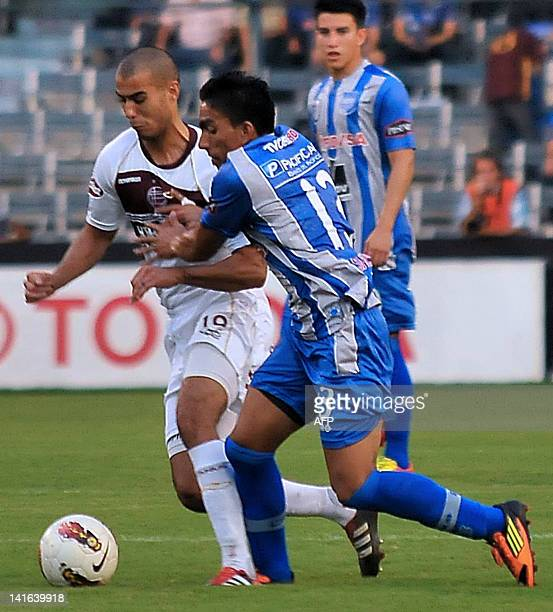 Guido Pizarro of Argentina's Lanus vies for the ball with Angel Mena of Ecuador's Emelec during their Copa Libertadores football match at Capwell...