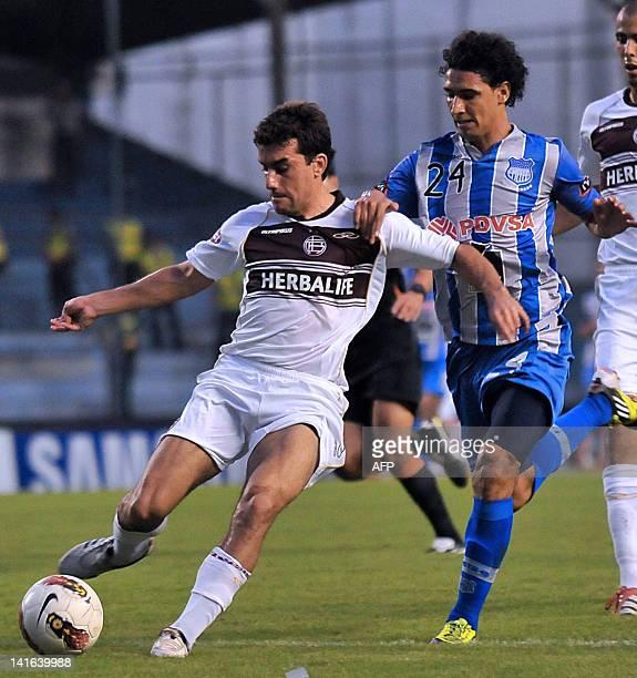 Guido Pizarro of Argentina's Lanus vies for the ball with Fernando Gimenez of Ecuador's Emelec during their Copa Libertadores football match at...