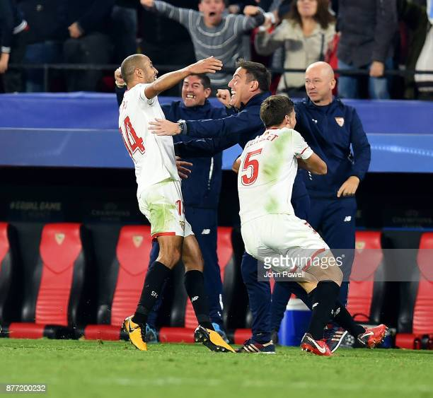 Guido Pizarro of Sevilla FC celebrates with Eduardo Berizzo manager of Sevilla FC after scoring the equalizing goal during the UEFA Champions League...