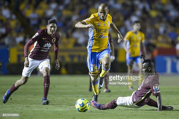 Guido Pizarro of Tigres fights for the ball with Darwin Quintero of America during the 3rd round match between Tigres UANL and America as part of the...