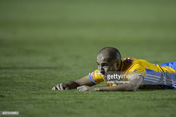 Guido Pizarro of Tigres lies on the ground during the 3rd round match between Tigres UANL and America as part of the Torneo Clausura 2017 Liga MX at...